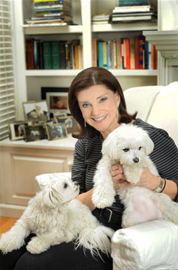 Lora Hemphill sitting with her dogs.